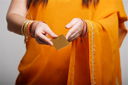 singapore traditional costume lady - Cropped shot of woman wearing sari,holding credit card Stock Photo - Premium Royalty-Free, Code: 655-03082800