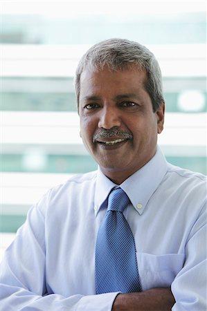 Head shot of Indian business man Stock Photo - Premium Royalty-Free, Code: 655-03457903
