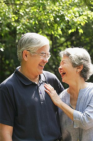 Senior couple facing each other, smiling Stock Photo - Premium Royalty-Free, Code: 656-01767730