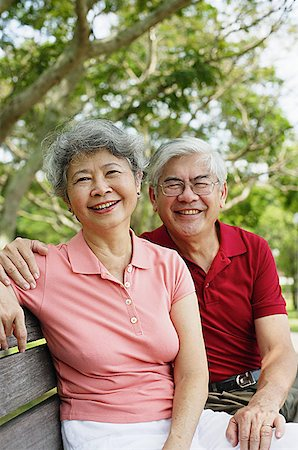 Mature couple on park bench, looking at camera Stock Photo - Premium Royalty-Free, Code: 656-01767774
