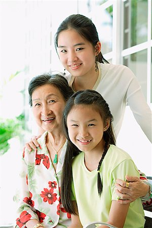 Grandmother sitting with her granddaughters Stock Photo - Premium Royalty-Free, Code: 656-01769287