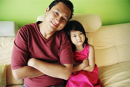 Father with one child, arms crossed Stock Photo - Premium Royalty-Free, Code: 656-01769511