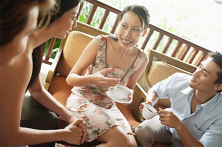 southeast asian - Woman sitting with friends having coffee Stock Photo - Premium Royalty-Free, Code: 656-01769940