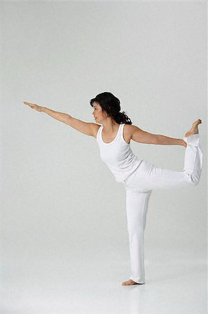 Woman practicing yoga Stock Photo - Premium Royalty-Free, Code: 656-02371645