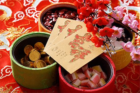 flower greeting - Still life of Chinese new year goodies Stock Photo - Premium Royalty-Free, Code: 656-02660209