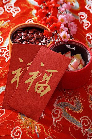 flower greeting - Still life of Chinese new year goodies Stock Photo - Premium Royalty-Free, Code: 656-02660213