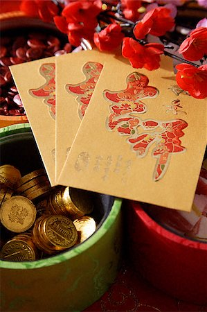 flower greeting - Still life of Chinese new year goodies Stock Photo - Premium Royalty-Free, Code: 656-02660261