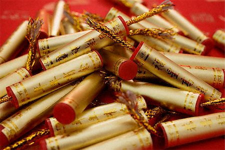Still life of Chinese New Year decorations, fire-crackers Stock Photo - Premium Royalty-Free, Code: 656-02660279