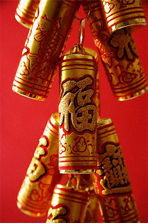 Close-up of Chinese New Year decorations, fire-crackers Stock Photo - Premium Royalty-Free, Code: 656-02660271