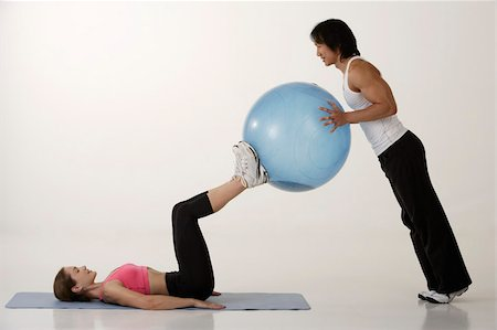 Couple working out with exercise ball Stock Photo - Premium Royalty-Free, Code: 656-02879610