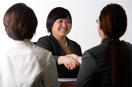 southeast asian - business woman shaking hands Stock Photo - Premium Royalty-Free, Code: 656-02879664