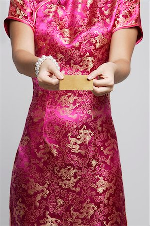 singapore traditional costume lady - cropped shot of woman in pink cheongsam Stock Photo - Premium Royalty-Free, Code: 656-03076254