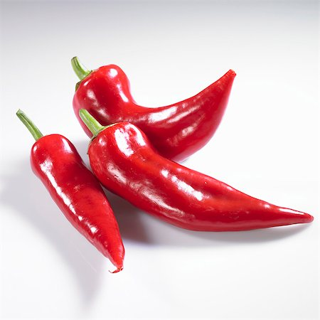 paprika - Three red pointed peppers Stock Photo - Premium Royalty-Free, Code: 659-06154322