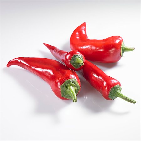 paprika - Four red pointed peppers Stock Photo - Premium Royalty-Free, Code: 659-06154323