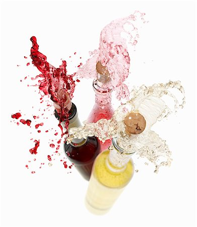 Wine spraying out of bottles (red wine, rose wine and white wine) Stock Photo - Premium Royalty-Free, Code: 659-06154371