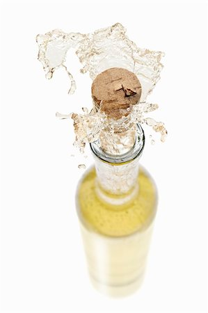 White wine spraying out of a bottle Stock Photo - Premium Royalty-Free, Code: 659-06154372