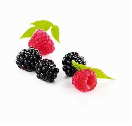 Blackberries and raspberries with leaves Stock Photo - Premium Royalty-Free, Code: 659-06154431