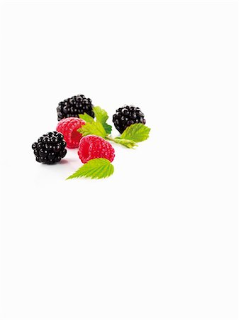 Blackberries and raspberries with leaves Stock Photo - Premium Royalty-Free, Code: 659-06154432