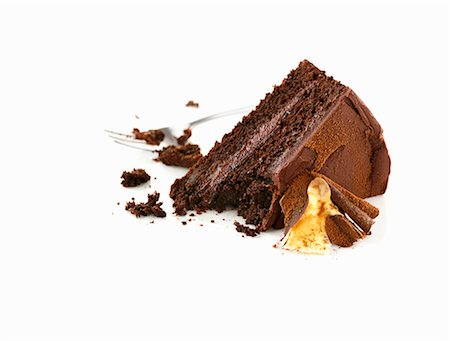 sweet - A piece of chocolate cake, partially eaten Stock Photo - Premium Royalty-Free, Code: 659-06154459