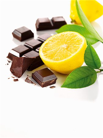 Lemons, lemon leaves and chocolate Stock Photo - Premium Royalty-Free, Code: 659-06154461