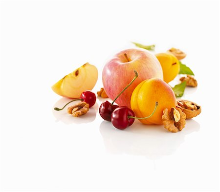 Apple, apricots, cherries and walnuts Stock Photo - Premium Royalty-Free, Code: 659-06154500