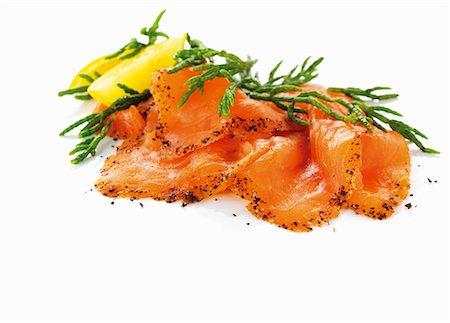 smoked - Slices of smoked salmon with glasswort Stock Photo - Premium Royalty-Free, Code: 659-06154685