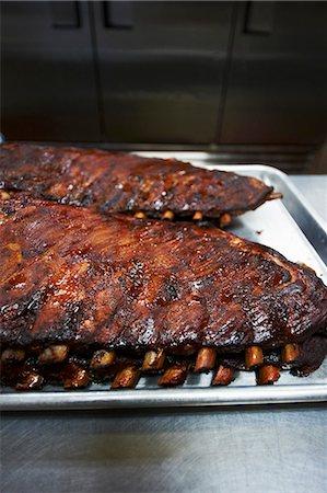 rib - Barbecue Pork Ribs on Baking Sheets Stock Photo - Premium Royalty-Free, Code: 659-06154965