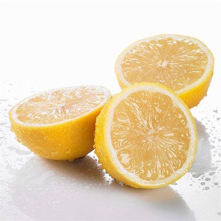 Three freshly washed lemon halves Stock Photo - Premium Royalty-Free, Code: 659-06155780