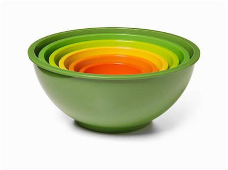 Mixing bowls of different sizes and colours stacked inside each other Stock Photo - Premium Royalty-Free, Code: 659-06151165