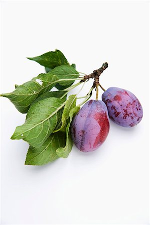 Plums with twigs and leaves Stock Photo - Premium Royalty-Free, Code: 659-06152604