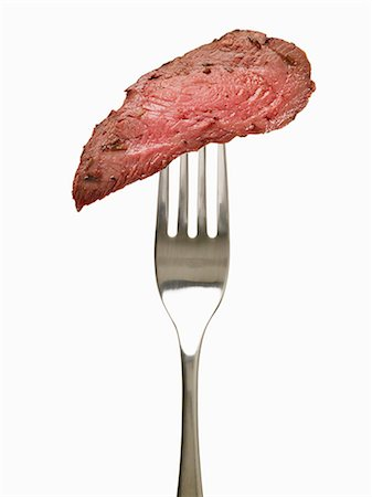 fork - Piece of Medium Rare Steak on a Fork Stock Photo - Premium Royalty-Free, Code: 659-06152736