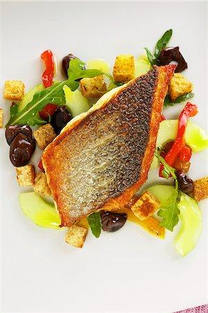 Bass on Ligurian bread salad Stock Photo - Premium Royalty-Free, Code: 659-06152994