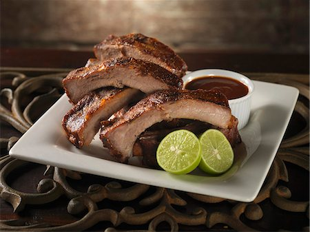 rib - Baby Back Ribs with Lime and Barbecue Sauce Stock Photo - Premium Royalty-Free, Code: 659-06153159