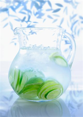 A jug of water with limes Stock Photo - Premium Royalty-Free, Code: 659-06153208