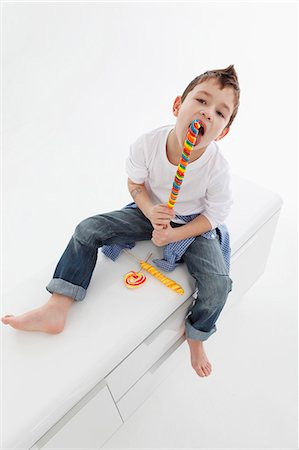 A little boy eating a giant lolly Stock Photo - Premium Royalty-Free, Code: 659-06153333