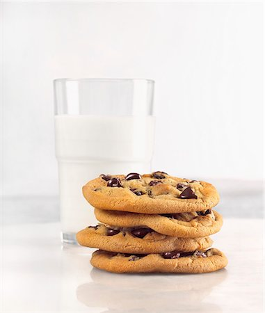 Milk and Cookies; Stack of Chocolate Chip Cookies with Glass of Milk Stock Photo - Premium Royalty-Free, Code: 659-06153448