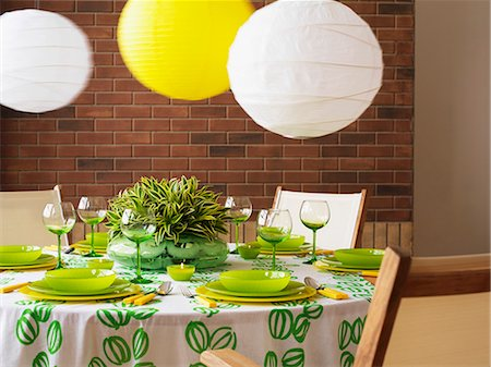 set - A green and white table with paper lampshades Stock Photo - Premium Royalty-Free, Code: 659-06153527
