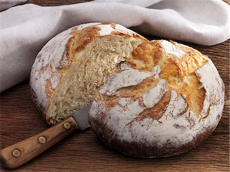 rustic - Buttermilk bread, sliced in half Stock Photo - Premium Royalty-Free, Code: 659-06153640