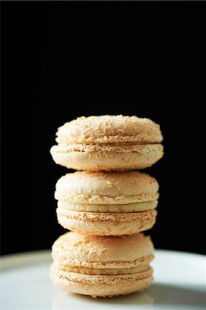 french (places and things) - Three Coconut Macaroons; Stacked Stock Photo - Premium Royalty-Free, Code: 659-06153885
