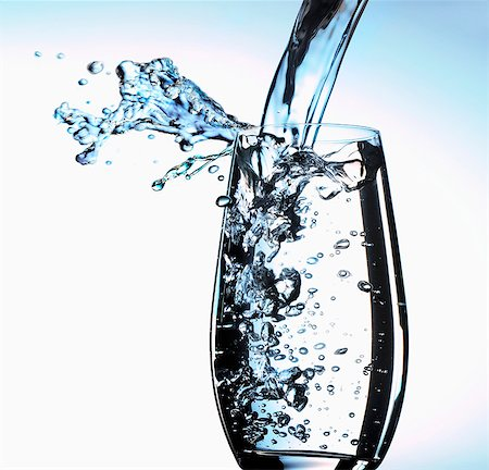 drinking water glass - Pouring water into glass Stock Photo - Premium Royalty-Free, Code: 659-06184085