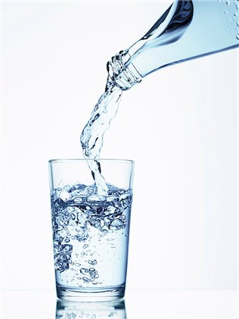 pouring - Pouring water from a bottle into a glass Stock Photo - Premium Royalty-Free, Code: 659-06184175