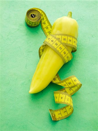 slim - A pointed pepper with a tape measure Stock Photo - Premium Royalty-Free, Code: 659-06184408