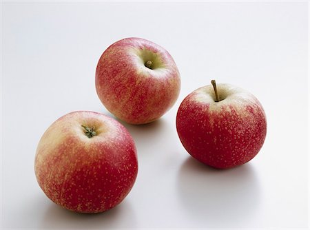 Three apples (variety 'Ingrid Marie') Stock Photo - Premium Royalty-Free, Code: 659-06184462