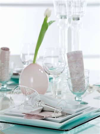 set - Festive table setting with a white tulip Stock Photo - Premium Royalty-Free, Code: 659-06184876