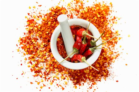 spicy - Dried chilli peppers and chilli flakes in a mortar Stock Photo - Premium Royalty-Free, Code: 659-06184925