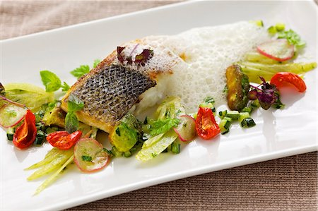 Fried branzino (sea bass) with spring vegetables and foam sauce Stock Photo - Premium Royalty-Free, Code: 659-06185095