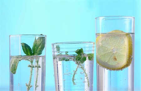 drinking water glass - Three glasses of flavoured mineral water Stock Photo - Premium Royalty-Free, Code: 659-06185254