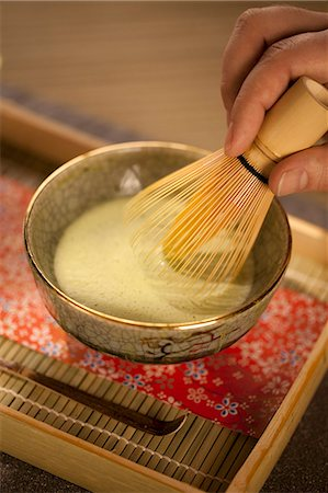 Mixing Japanese Matcha Green Tea in a Ceremonial Bowl with Whisk Stock Photo - Premium Royalty-Free, Code: 659-06185654