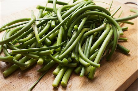 stick - Garlic Scapes; The Green Part of the Garlic Plant; On Cutting Board Stock Photo - Premium Royalty-Free, Code: 659-06186516