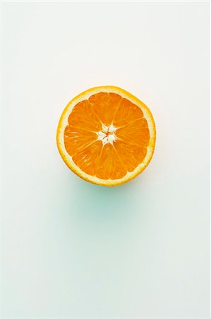 Half an orange Stock Photo - Premium Royalty-Free, Code: 659-06187074